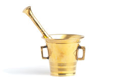 Antique brass mortar and pestle set. Over white background Royalty Free Stock Images