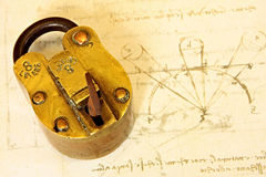 Antique Brass Padlock. On a page of Da Vinci's writings. 19th Century vintage Indian padlock royalty free stock images