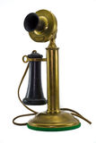 Antique Brass Phone. A Brass Antique phone on a white background Royalty Free Stock Images