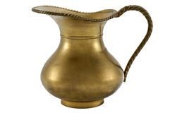 Antique brass pitcher on white background Royalty Free Stock Photos