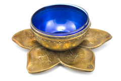 Antique brass pot with blue glass Royalty Free Stock Photography
