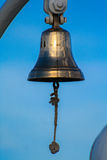 Antique brass ship bell blue sky background Stock Photography
