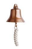 Antique brass ship's bell with a rope  Stock Images