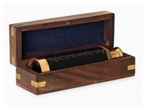 Antique brass telescope. In wooden box over white, clipping path Royalty Free Stock Images