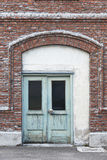 Antique brick facade with green doors. Old style warehouse entra Royalty Free Stock Image