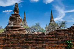 Antique Brick wall with Great Pagoda background. In Ayutthaya Historical Park.Public Place Royalty Free Stock Photo