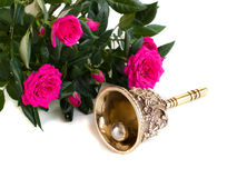 Antique bronze bell and bouquet of roses. On a white background Royalty Free Stock Photos