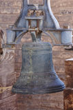 Antique bronze bell with mechanism on a bell tower Royalty Free Stock Photo