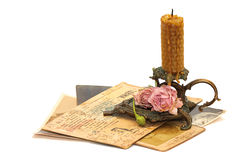 Antique bronze candlestick and old photos Royalty Free Stock Photos