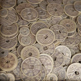 Antique bronze Chinese coins. Close-up background with selective focus on the middle Royalty Free Stock Images