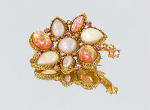 Antique brooch on a mirror stock images