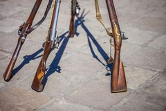 Antique Brown Bess muskets used for the reenactment of the Battle of the Alamo stock photo