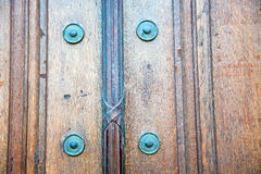 In   antique brown door  rusty  brass nail and light Royalty Free Stock Photography