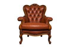 Antique brown leather chair. Isolated on white stock photos