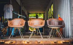 Antique Brown Leather Cushion Chair. With Casual Vintage Design Style royalty free stock photos