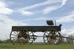 Antique buckboard sky background. In open field Royalty Free Stock Image