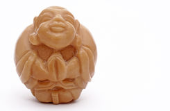 Antique Budda carving. Isolated photo of an Antique Budda carving Royalty Free Stock Photography