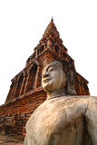 Antique Buddha Statue. An old Budhha statue with old pagoda in the background. This statue was created with northern style of Thai Art, can be found at north of Stock Photos