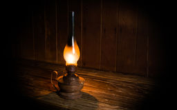 Antique burning paraffin lamp. Royalty Free Stock Images