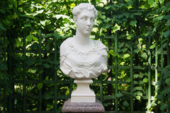 Antique bust at the green fence Royalty Free Stock Photo