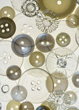 Antique Buttons. Background comprising antique clear and pearl buttons stock image
