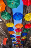 Antique bystreet decorated with colored umbrellas. Royalty Free Stock Photos
