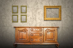 Antique cabinet wood and old picture frame Stock Image