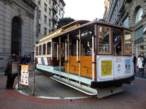 Antique Cable Car on Powell Street Turntable as the car is turne. SAN FRANCISCO - JANUARY 3: Antique Cable Car on Powell Street Turntable as the car is turned Stock Image