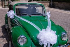 Antique cabrio car. Green, Volkswagen Beetle. For wedding service. royalty free stock photography