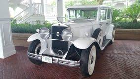 Vintage Cadillac. A white circa1929 v8 Vintage Cadillac at Disneys Grand Floridian hotel Royalty Free Stock Photos