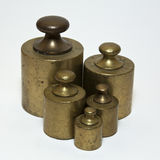 Antique calibration weights. Five antique calibration weights  on white Royalty Free Stock Photos