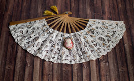 Antique cameo brooch on lace fan Royalty Free Stock Photography