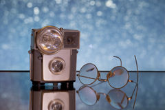 Antique camera and glasses Royalty Free Stock Images