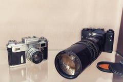 Antique cameras with telephoto lenses Stock Photo