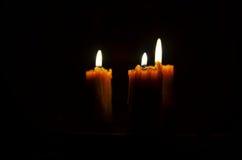 Antique candle burning Stock Image