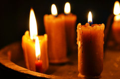 Antique candle burning Royalty Free Stock Images