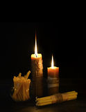 Antique candles in the darkness Royalty Free Stock Image