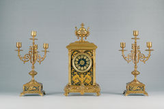 Antique  candlestick and clock Stock Image