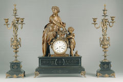 Antique  candlestick and clock Stock Photo