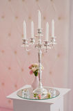 Antique candlestick with wedding bouquet. stock photo