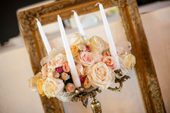 Antique candlestick with wedding bouquet Stock Photo
