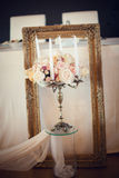 Antique candlestick with wedding bouquet. Wedding background royalty free stock photos