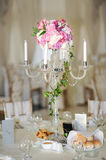 Antique candlestick with wedding bouquet.wedding candlestick with flower decoration before wedding ceremony. stock photo