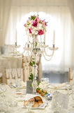 Antique candlestick with wedding bouquet.wedding candlestick with flower decoration before wedding ceremony. Royalty Free Stock Photos