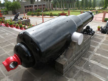 Antique cannon. Rear view of antique military cannon outdoors, Pune city, India Royalty Free Stock Photo