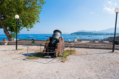 Antique Canon looking towards the seacoast inside the Old Fortress. Corfu island,Greece. Stock Image