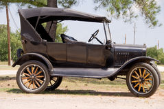Antique Car. An old vintage antique car in mint condition Royalty Free Stock Photo