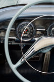 Antique car dashboard. The steering wheel and dashboard of an antique classic car Royalty Free Stock Images