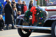 Antique car driving through the Annual Holiday Parade,Glens Falls New York,2014 Stock Photos