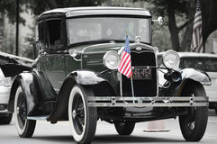 Antique Car with Flag Royalty Free Stock Photo